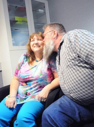 Sandy Trinham gets a kiss from her husband Dave after her cochlear implant is switched on.
