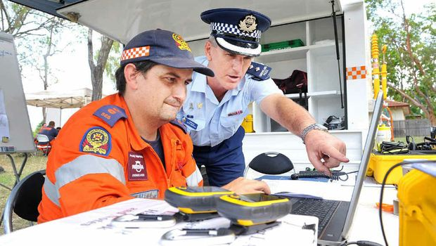 SEARCH: SES Group Leader Jeff Lindsay and Inspector Keith McDonald co-ordinate the hunt for missing man Reece Austin.