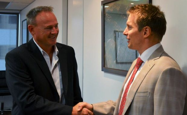DONE:Executive officer for Regional Development Australia Wide Bay Burnett Paul Massingham and Hancock Coal managing director Paul Mulder seal the deal to establish FIFO services in the Wide Bay Burnett region with a handshake earlier this week.