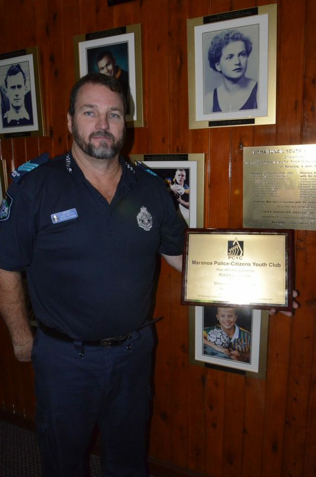 PCYC co-ordinator and manager Sgt Greg Caletti, showing the gym's official opening plaque.