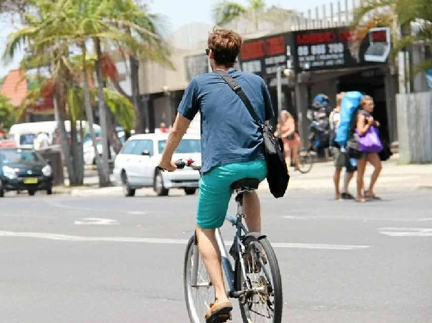 NO SAFETY HELMET: A regular sight in the streets of Byron Bay and one there may be little point in fighting.