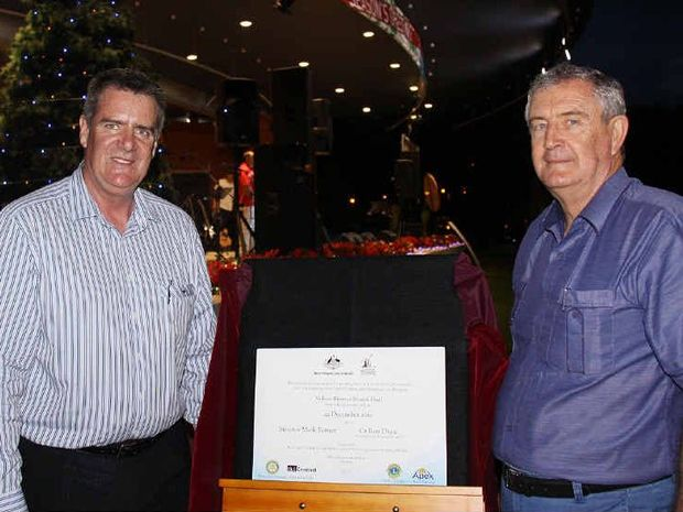 Federal Senator Mark Furner and Mayor Ron Dyne open the soundshell roof at Nelson Reserve.