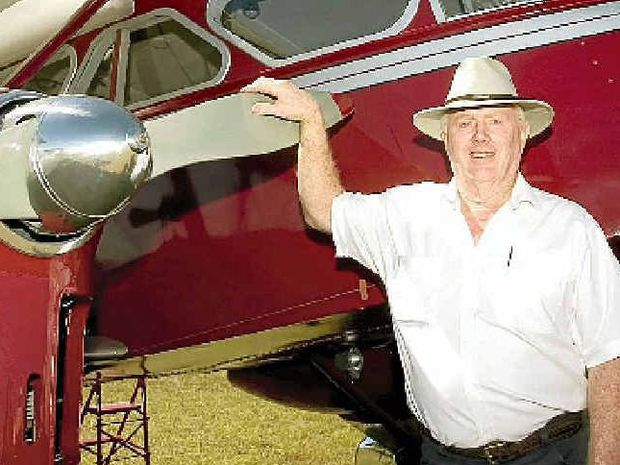 SO CLOSE: Pilot Des Porter with the ill-fated plane that crashed, killing six people.
