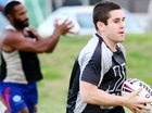 Ipswich Jets players on their first night back for pre-season training. Dane Phillips runs with the ball.