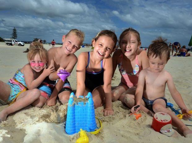 Eve, Jack, Emma, Heidi and William Wood at Coolangatta beach. Photo: John Gass / Daily News