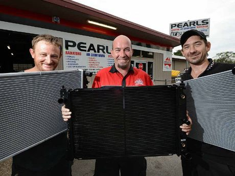 BUSY STAFF: Warwick Martin, owner of Pearls Radiator, Mechanical and Auto Air Conditioning (centre), with employees Graham Sangster and Matty Kerridge at the front of the Ipswich workshop.