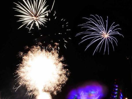 OUT WITH A BANG: Families enjoy the fireworks spectacular at North Ipswich Reserve last night.