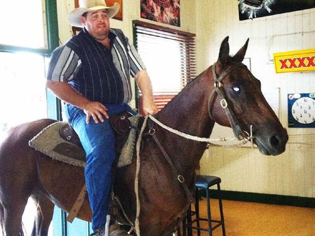 RARE VISITOR: Pat Lenihan sometimes brings his mate Stagecoach into the bar as he did in Rosewood.