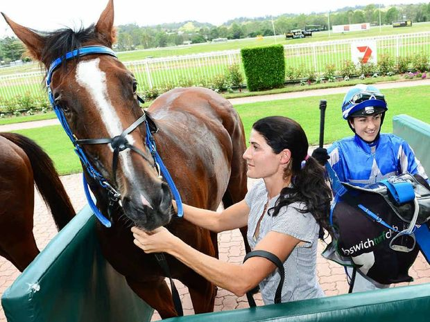 MONEY GRABBER: City of Ipswich Plate winner Grabthemoney'n'run with jockey Tegan Harrison (right).