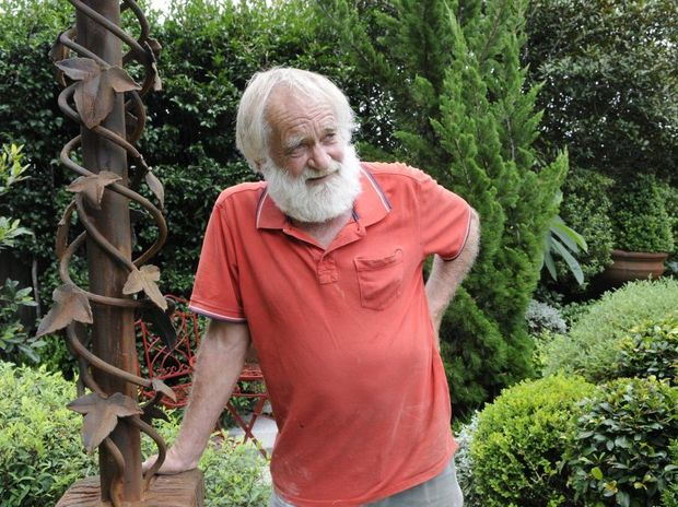 Roy Brunner shows off one of his more intricate garden creations.