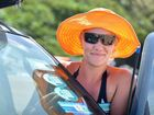 Kristie Bazley puts a permit sticker on her vehicle before heading to Double island Point.