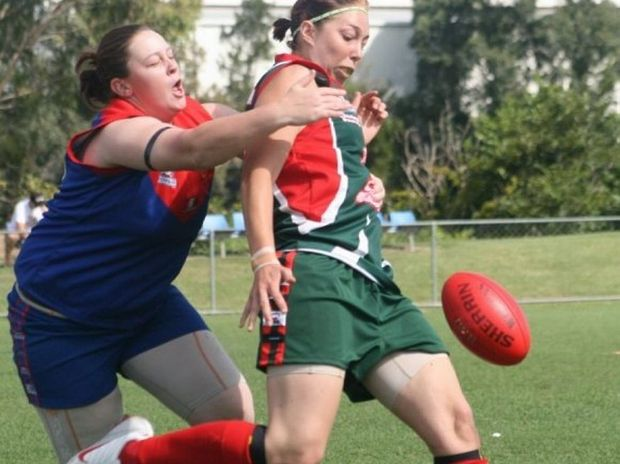Monique Lepri lays a tackle on a Logan player while playing for Kedron. Photo Contributed