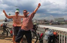 We made it all the way from Scotland! Marty Gordon and Alex Hotchin celebrate the end of their 18-country bicycle trek in Phnom Penh, Cambodia.