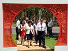 NANNING VISITORS: Mayor Mal Forman leads the Chinese delegation through the entrance to the Chinese garden at the Botanical Gardens.