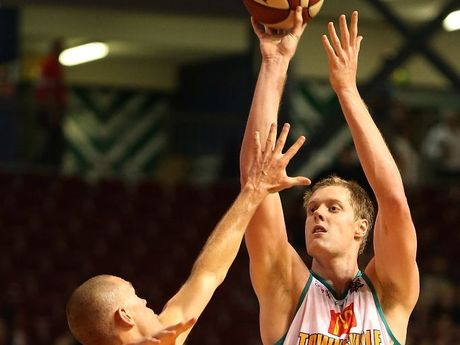 Luke Neville of Townsville goes for three points during the round 13 NBL match between the Adelaide 36ers and the Townsville Crocodiles at Adelaide Arena on January 4, 2013 in Adelaide, Australia.