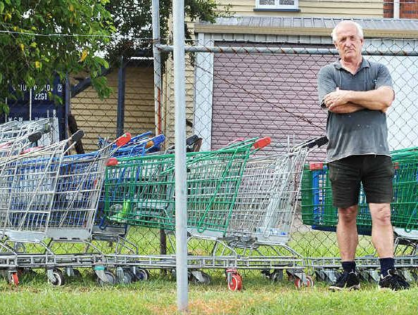 HOLDING YARD: Booval Second Hand owner Nick Koomen is unhappy about having to collect abandoned trolleys.