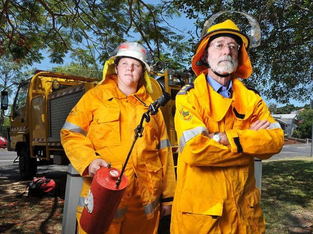 PREPARED: Pine Mountain Rural Fire Brigade first officer Denis Mahon (right) and firefighter Ailsa Christensen.
