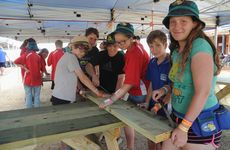 Scouts from Blacktown in New South Wales work on constructing a picnic table at the 2013 Scout Jamboree. Photo: Megan Pope / Fraser Coast Chronicle
