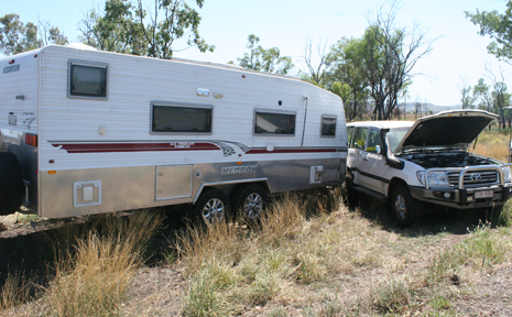 NO SO HAPPY HOLIDAY: This caravan was side swiped on the Burnett Highway, just outside Thangool, on Wednesday after a semi-trailer attempted to overtake it.