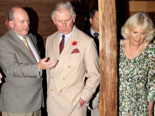 ROYAL VISIT: Prince Charles, the Prince of Wales, centre, and his wife Camilla, the Duchess of Cornwall, right, look at items on display at the Stockman museum after arriving in Longreach.
