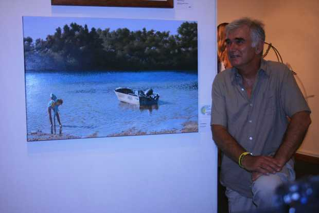 ACQUIRED TASTE: Geoff Williams with his painting Worm Hunter, which was awarded the Acquisitive Prize in the 2013 Arts Classic on Friday night. The work will become a part of Byron Shire Council's collection. Photo Digby Hildreth / Byron Shire News