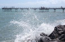 Waves crash onto rocks near the Scarness Pier during the king tide.