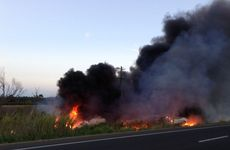 A semitrailer, which became engulfed in flames after a crash on the Bruce Hwy on Sunday, caused a grassfire at Glenwood.