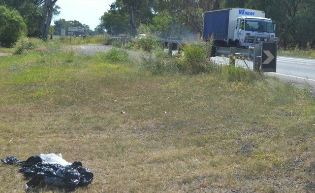 Rubbish strewn at Roma's Ewan Bridge is among the many complaints of untidiness from Western Star readers.