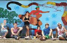 THE HOOD: Local Riverview kids join Annie Clarke (centre) to paint a toilet block at Maculata Family Park in Riverview.