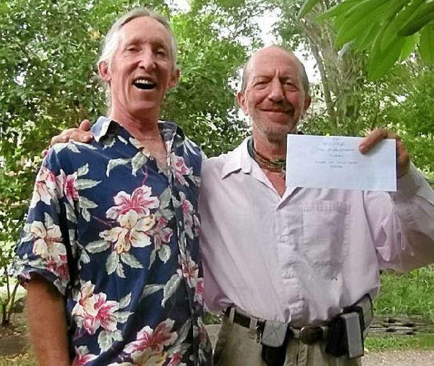 BOOST: Eric Bridgeman and snake wrangler George Ellis.