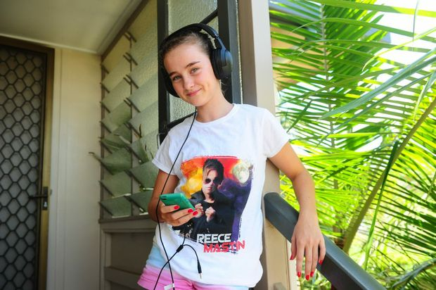 Tian Kingsbury listens to music on her iPod.