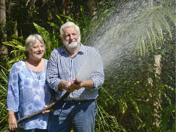 Helen and Ross Pye of Ashby with a hose run from their own fire-fighting pump. Photo: Adam Hourigan