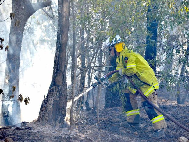 Firefighters control a fire on Newspaper Hill Rd, Belli Park.