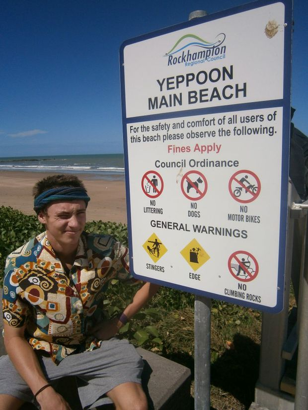 Duncan Mitchell takes heed of stinger warnings on Main Beach, Yeppoon.