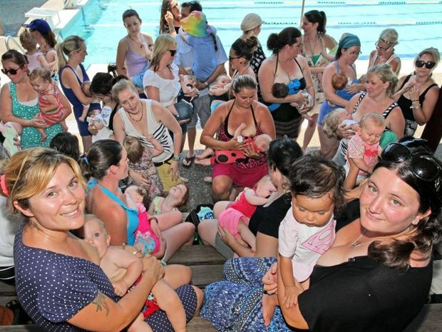 Lactation consultant Meg Nagle with son Malachi and Liana Webster with her sion Rori Webster-Ca milleri are joined with dozens of breast feeding mums at the Bribie Island Aquatic Centre to raise aweness of their right to breastfeed in public. Photo: Darryn Smith