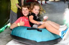 Broden Ingram, 11, and Kiara Ingram, 3, of Harrisville, enjoy the slide.