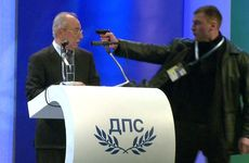 Photo: Bulgarian television channel BTV captured this footage of the man holding a pistol at Ahmed Dogan's head. (AFP/BTV)