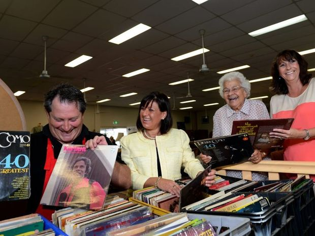 Cliff Hawkey, Justine Elliot, Aunty Cath Lena and Leonie Crayden look through some old vinyl records for a hidden gem at Repsychlers.
