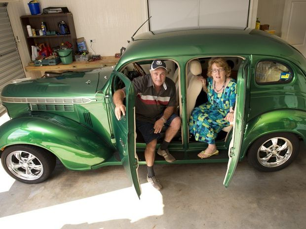 ( from left ) Steve Michael has restored what could be Carol Bateman's old Chrysler Royal . Photo Nev Madsen / The Chronicle