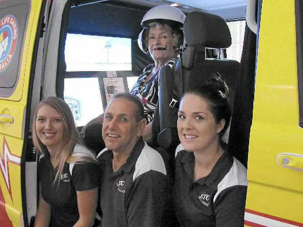 ETC staff and director Lorraine Mouafi give the Westpac Rescue Helicopter simulator a test flight.