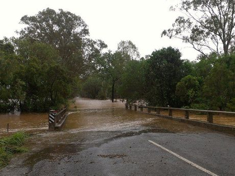 Flooding on the Hut Creek bridge on Gentle Annie Rd, Ambrose.