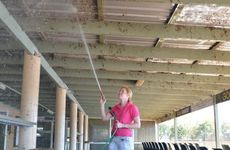 Sharon Jaenke lends a hand to Football Gympie to clean up the clubhouse.