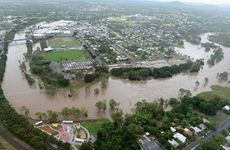 SURROUNDED: The Bremer River at Riverheart Parklands and North Ipswich on Monday.