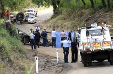 Police remove the body of Andrew Leong yesterday from Sandy Creek.