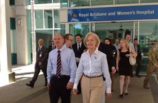Premier Campbell Newman (left) and wife Lisa (not shown) with Governor-General Quentin Bryce (right) after visiting patients airlifted from Bundaberg Hospital to Brisbane.