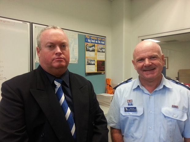 Detective Senior Sergeant Joe Hildred and Acting Superintendent Mark Henderson at a press conference in Bundaberg today.