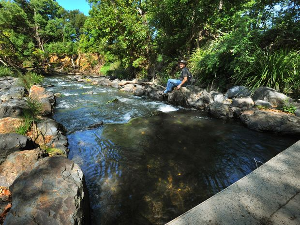 Conservation legend Ron Smith takes a breather at the Orara River fish ladder near Karangi.