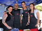 Line forms as My Kitchen Rules teams set up sausage sizzle