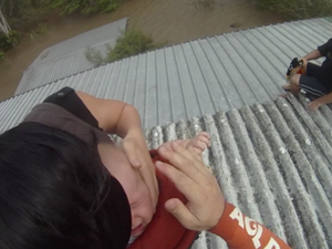 Couple and baby rescued from roof