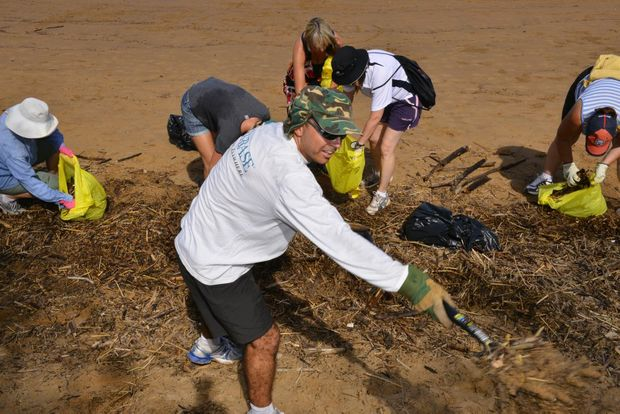 CLEAN UP: Neil Dingley joined the crowds that showed up for the Bargara Beach cleanup. Photo: Scottie Simmonds / NewsMail